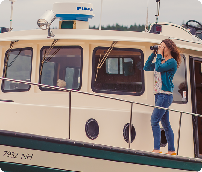 miramonee harrington on boat with binoculars
